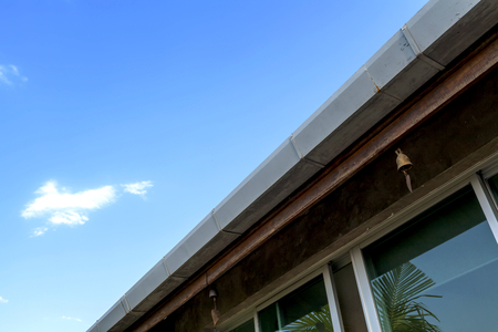 House gutter with sky background Stock Photo