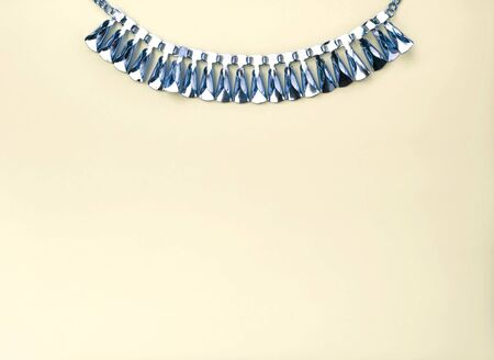 blue design: Blue design necklace on top of yellow