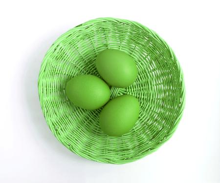 green tone: Eggs in basket on white green tone