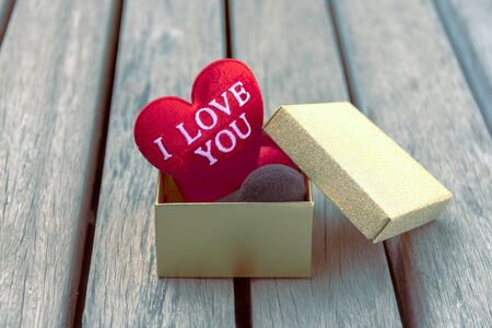 heart tone: Red heart in gold gift box vintage tone style Stock Photo