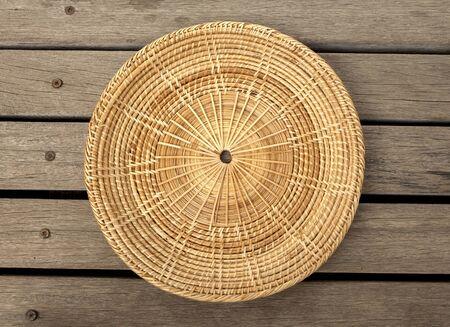 wood floor: Rattan placemats on wood floor center Stock Photo