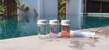 Closeup Water testing result on swimming pool edge