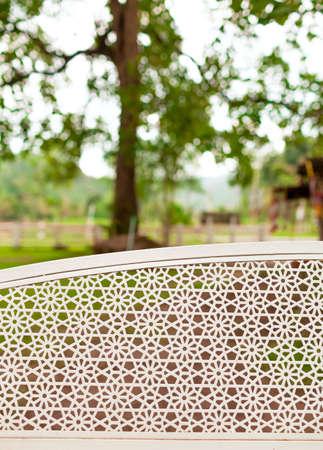garden chair: Garden chair pattern with big tree background