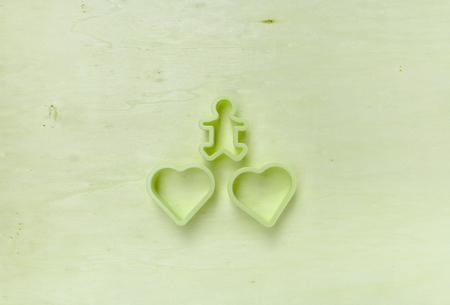 cookie cutter: Vintage green tone Two cookie cutter heart shape on wood background
