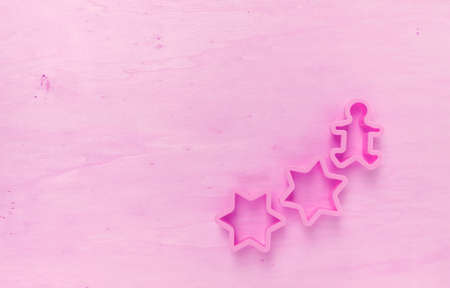 wood cutter: Pink tone wood background with star cookie cutter Stock Photo