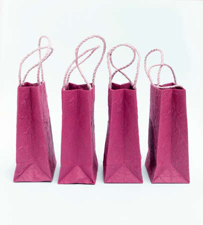 aisa: Pink shopping bag on white background from the side
