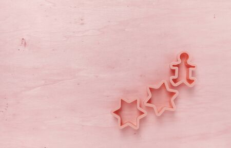 cookie cutter: Red tone wood background with star cookie cutter