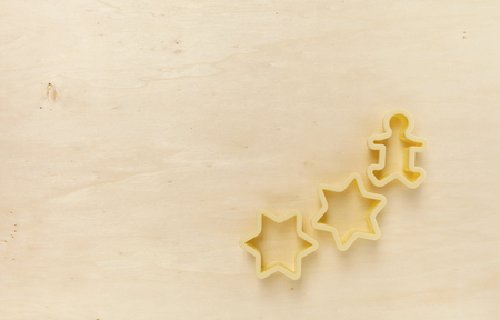 wood cutter: Yellow tone wood background with star cookie cutter