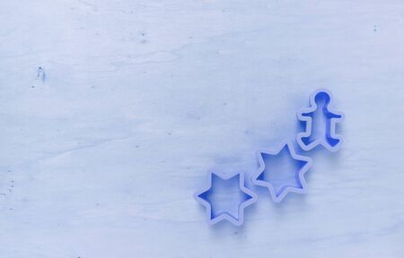 wood cutter: Blue tone wood background with star cookie cutter