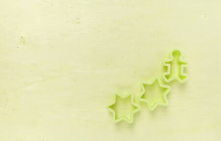 wood cutter: Green tone wood background with star cookie cutter Stock Photo