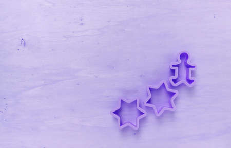 wooden texture: Purple tone wood background with star cookie cutter Stock Photo