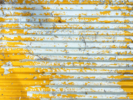 wall paint: Old yellow paint on metal wall Stock Photo