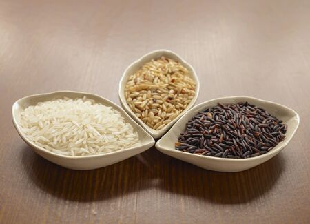 grain and cereal products: rice, brown, white, black, background, bowl, raw, food, healthy, nobody, organic, wild, view, closeup, grain, red, cereal, grains, uncooked, close-up, group, ingredient, vegetarian, dry, oriental, seed, products, various, natural, detail, gourmet, culture