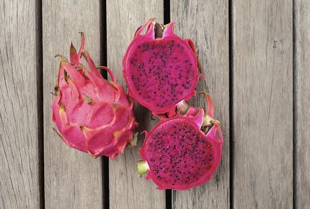 Closeup Red Dragon fruit on wooden floor Stok Fotoğraf - 44375733