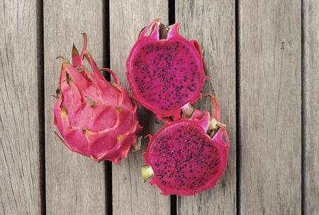 Closeup Red Dragon fruit on wooden floor