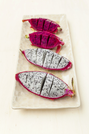 dragon vertical: Dragon fruit on ceramic plate vertical style