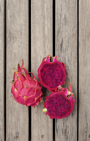 dragon vertical: Red Dragon fruit with space on wooden floor vertical style