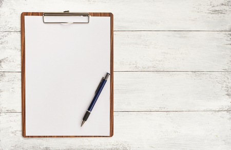 clipboard: Blank paper on wooden clipboard with space on background