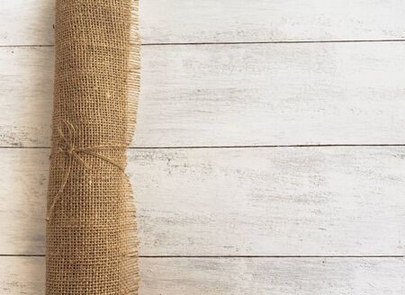 fabric roll: Hessian fabric roll on wood background Stock Photo