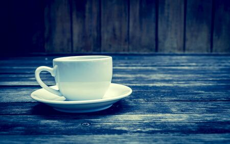 blak and white: Vintage cool tone coffee cup on wood floor