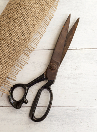 hessian: Closeup Hessian roll and old scissors