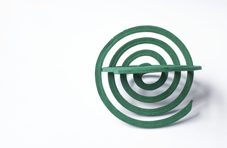 coils: Green mosquito repellent coils on white background