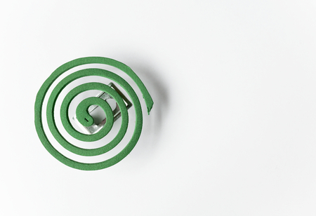repellant: Green mosquito repellant coils with space on white background