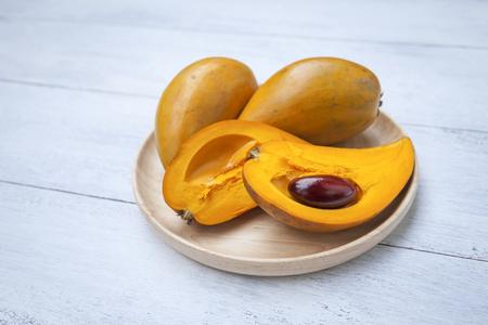 Eggfruit on wooden tray