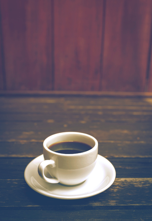 blak and white: Coffee with space on wood background vintage tone style