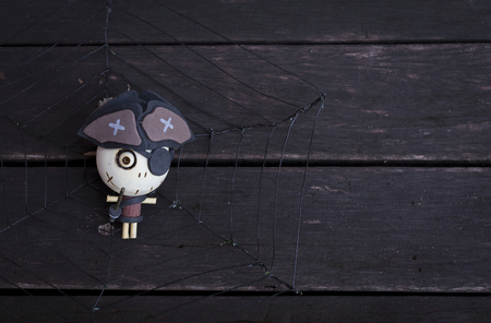 wood spider: Piret ghost wood doll on spider web with space on dark wood Stock Photo