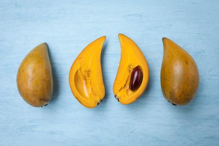 Egg fruit on wooden blue background