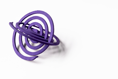 coils: Two purple mosquito repellent coils with space on white background