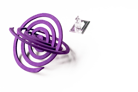 coils: Lavender mosquito coils with space on white background