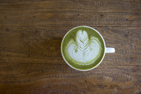 gree: Gree ntea latte with space on wood background