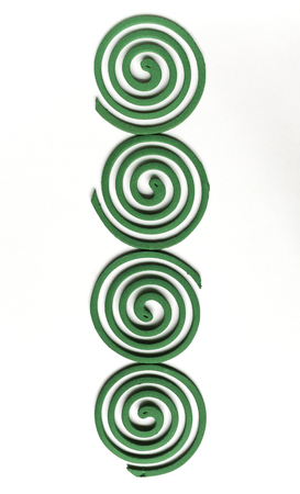 coils: Green mosquito coils on white background