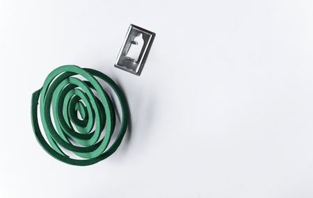 anti season: Green mosquito coil with space on white background