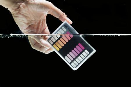 Water testing test kit on black background
