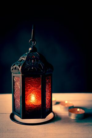 The red light in metal lamp with black background, vintage style Stock Photo