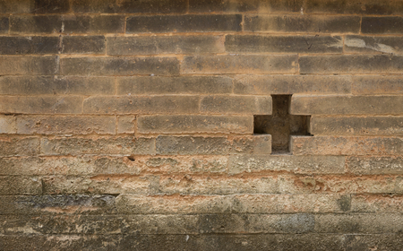 old sign: Cross sign on the old brick wall Stock Photo