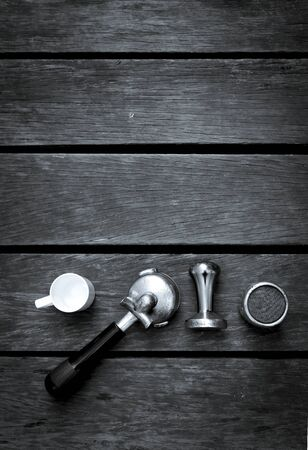 bar tool set: Abstract black and white tone espresso equipments on wood background, vertical style Stock Photo