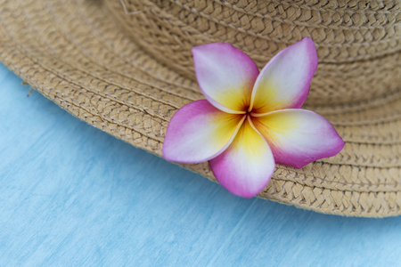 concep: Plumeria flower on the hat, summer background concep