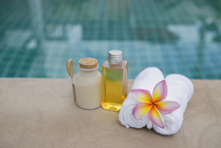 hand towel: Spa concept background, white hand towel with plumeria flower at poolside