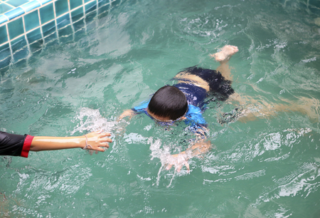 life guard: Kid drowning in the swimming pool, life guard, drowing victim, boy in the pool