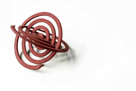 anti season: Red mosquito coil with space on white background Stock Photo