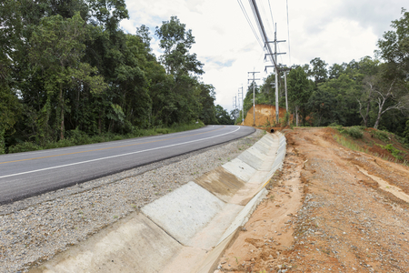 land slide: Road side work in Thailand, land slide problem, water channel Stock Photo