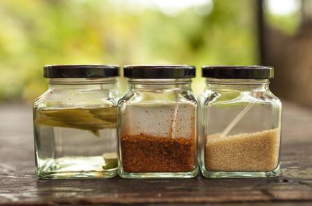 translucent red: Chili in vinega, sugar and chili powder in glass bowl