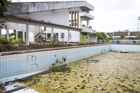 gunk: Damaged old public swimming pool, outdoor day light Stock Photo