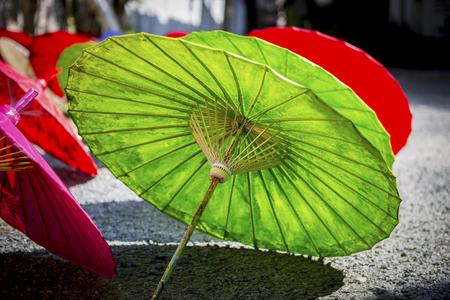 paper umbrella: Summer concept, Colorful wooden umbrella design, outdoor day light