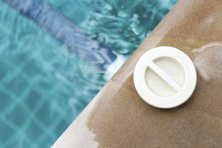 sweeper: Swimming pool Vacuum Fitting, outdoor day light in summer