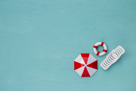 lifeguard chair summer concept background beach chair and umbrella with life buoy over blue